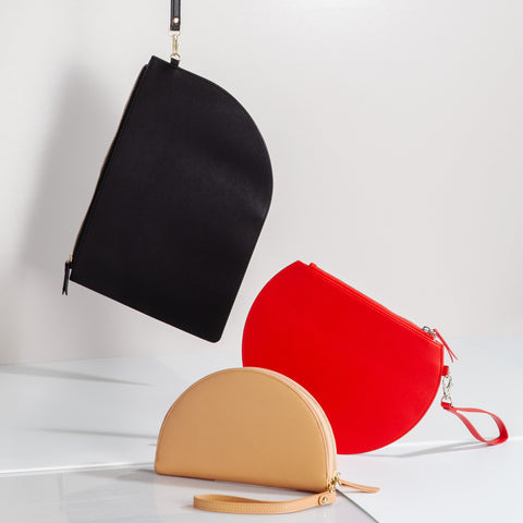 3/4 Moon Clutch in Red Curve Clutch in Black Half Moon Clutch in Tan Lifestyle