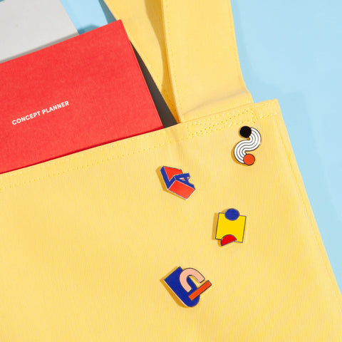 Geometric Enamel Pins on Bag