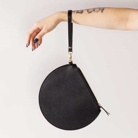 3/4 Moon Clutch in Black being held