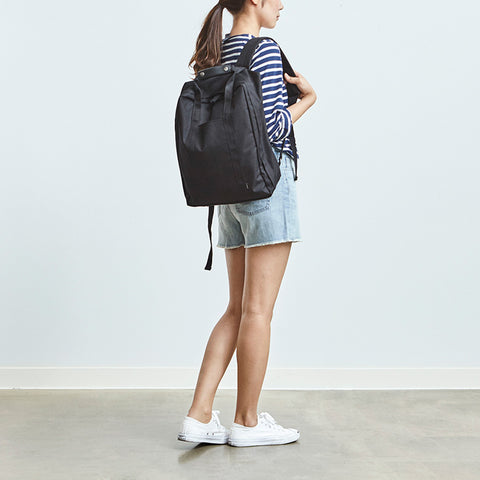 Model with voyager backpack