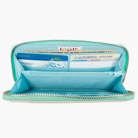 laminated canvas zip wallet blue wave by Cole Gerst