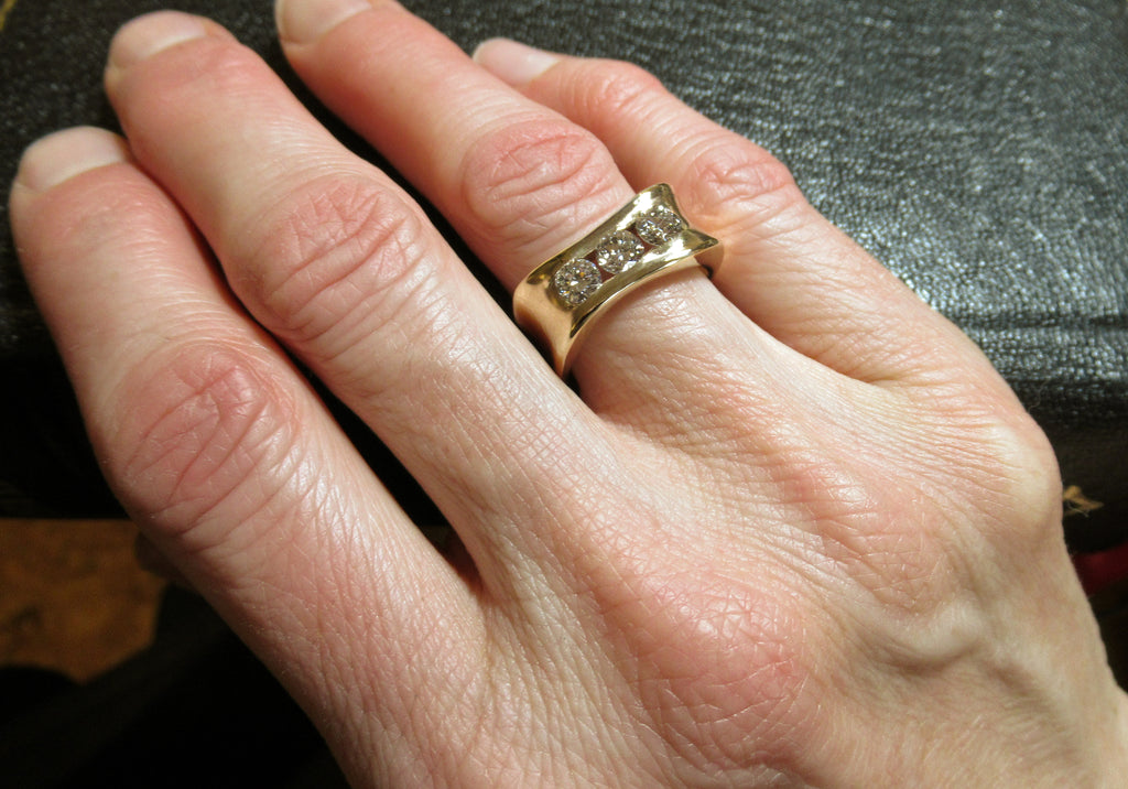 Custom designed and handcrafted Organically you 14kt yellow gold 3 diamond anniversary band. This band was designed around 2 recycled diamonds of Anne's, and a third added.  Canadian, Local, handmade Custom diamond rings by ZEALmetal in Kingston ON.