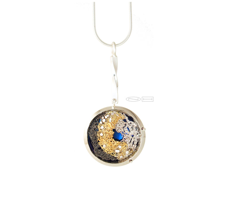 Handcrafted ~captured thought ~ 22kt yellow gold crochet, fine silver crochet, blacken crochet, stitched together, and placed upon an anodized titanium disc, framed in stainless steel, with sterling silver rivets, hanging from a twisted bail bar, with matte and high polish finish. Local Canadian handmade in Kingston, ON