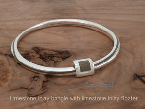 Limestone inlay bangle with floater