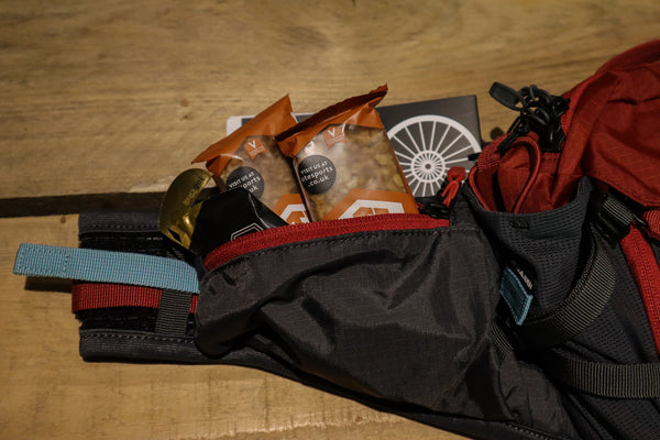 Some trail snacks fit in the side pockets as well as Keys.