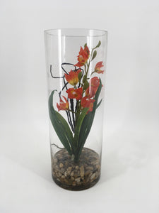 Orange Flower in Glass Vase with Rocks