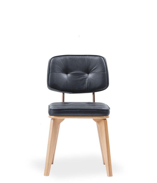 Modern chair, light wood legs and black leather seat and back. Front view