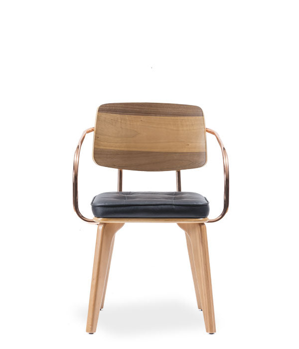 Modern chair, light wood legs and black leather seat and wood back. Metal tube armrests and back detail. Front view