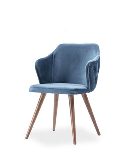 Fully upholstered blue armchair. Rounded back with tufting on the outside, angled wood legs. Front 3/4 view.