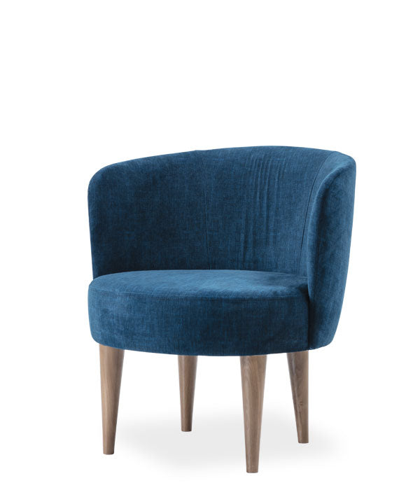 Large blue upholstered chair, round seat and curved back with rolled edge. Front 3/4 view.