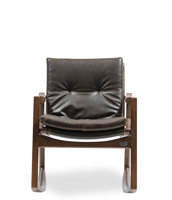 Mid-century styled rocking chair. Dark wood frame and thick leather cushions. Front view.