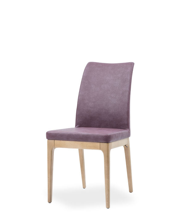 Mauve fabric covered dining chair with wood legs. Chair back curves back slightly. Front 3/4 view.