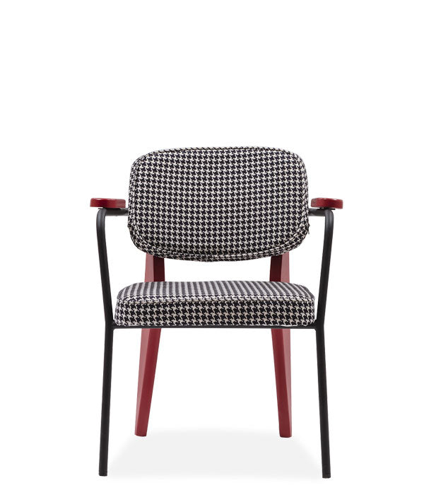 Graphic armchair with 2-toned frame and geometric back legs. Padded seat and back. Front view.