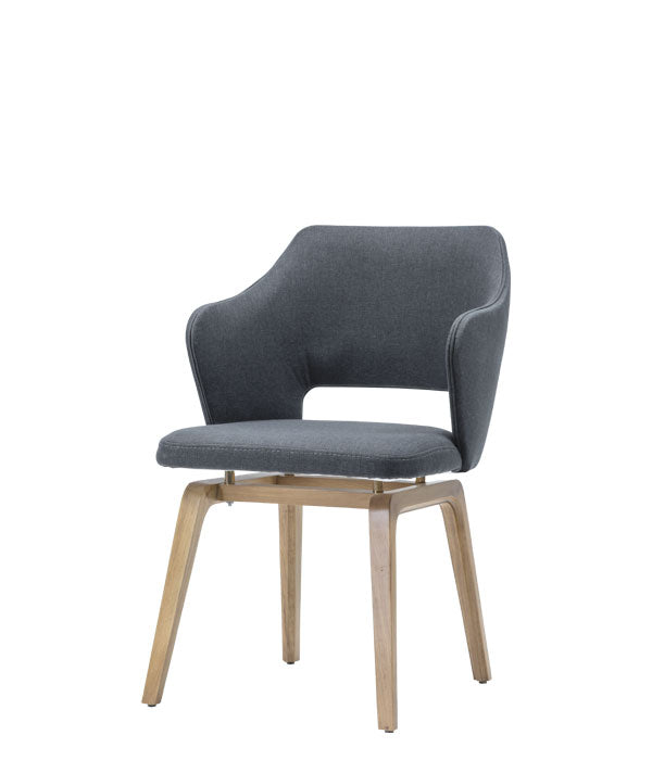 Padded armchair with low back cut out and gap between the seat and legs. Front 3/4 view.