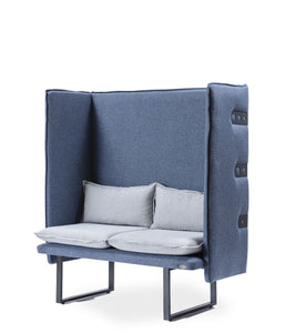 Slate blue padded booth with tufted exterior and u-shape metal feet. Removable light blue cushions. 3/4 front view.