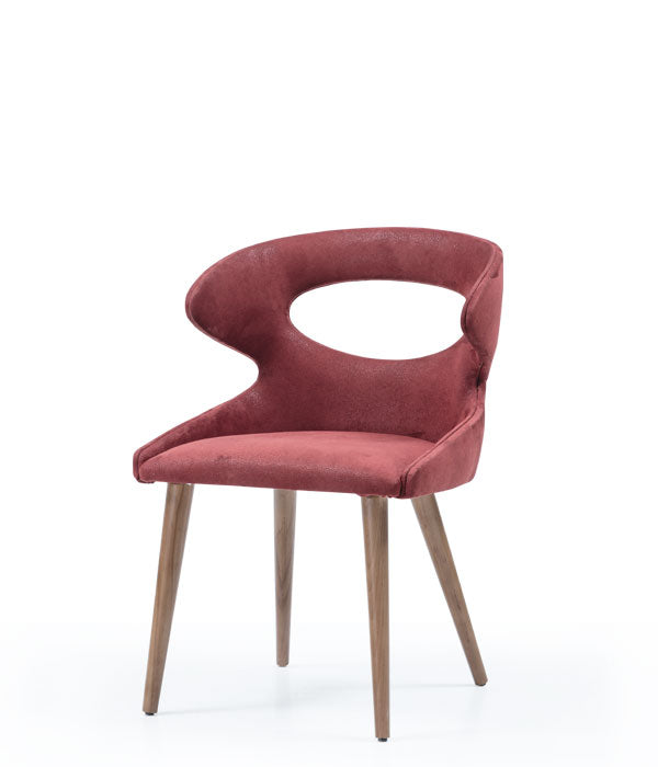 Modern wrap around chair, fully upholstered with an oval cut out. Front 3/4 view.
