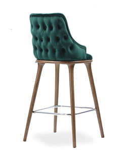 Fabic covered bar stool with a squared, fully tufted chair back. Back 3/4 view.