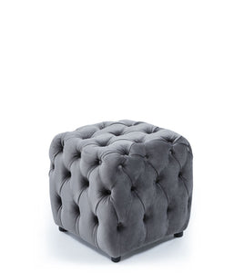 Grey upholstered cube ottoman. Fully tufted on all sides.