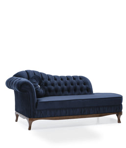 Navy blue, divan style sofa with thick tufted upholstery. Front 3/4 view.