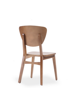 Wood dining chair with open back. Back view