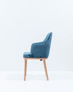 Blue dining armchair with curved sides. Side view.
