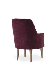 Wine coloured, fabric covered armchair. Back view.