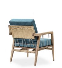 Wood framed lounge armchair with rustic cord details. Thick blue cushions on seat and back. Back 3/4 view.