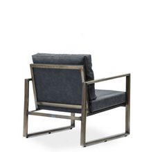Modern angular arm chair with steel frame and black leather cushions. Back 3/4 view.