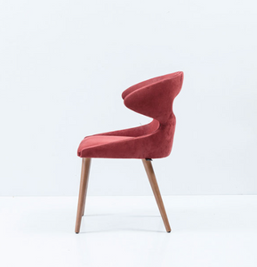 Modern wrap around chair, fully upholstered with an oval cut out. Side view.