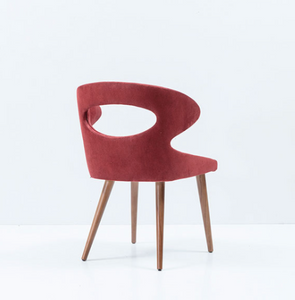 Modern wrap around chair, fully upholstered with an oval cut out. Back 3/4 view.