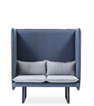Slate blue padded booth with tufted exterior and u-shape metal feet. Removable light blue cushions. Front view.