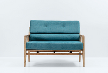 Wood framed lounge sofa with rustic cord details. Thick blue cushions on seat and back. Front view.