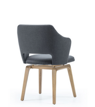 Padded armchair with low back cut out and gap between the seat and legs. Back 3/4 view.