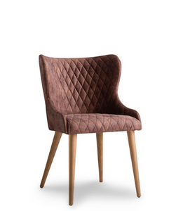 Short-backed wingback chair. Quilted brown fabric and wood legs. Front 3/4 view.