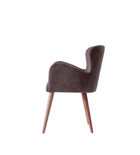 Short backed wingback chair with arms. Brown fabric and wood legs. Side view.