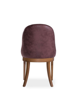 Red upholstered, horseshoe shaped back chair with curved back legs. Back view.