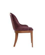 Red upholstered, horseshoe shaped back chair with curved back legs. Side view.