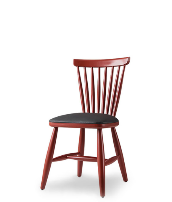 Red painted wood dining chair with black leather seat and spindle back. Front 3/4 view.