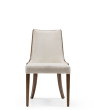 Cream fabric covered dining chair with curved wood legs and wood veneer back. Chair back curves around the body slightly. Front view.