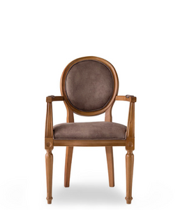Traditional style dining chair with an oval back and carved wood frame, arms and legs. Brown upholstery, front view.