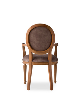 Traditional style dining chair with an oval back and carved wood frame, arms and legs. Brown upholstery, back view.