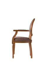 Traditional style dining chair with an oval back and carved wood frame, arms and legs. Brown upholstery, side view.