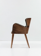 Chair, wingback style with wraparound wood veneer. Side view