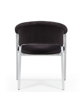 Modern tub chair. Dramatic A-frame sides painted white with black fabric back and seat. Back view.