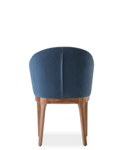 Blue upholstered club chair style dining chair with back seam detail. Back view.