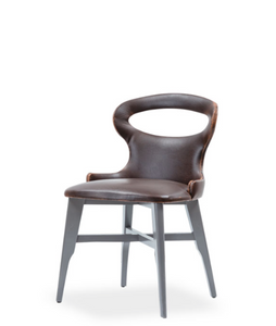 Architectural leather chair with oval opening on the seat back. 3/4 front view.