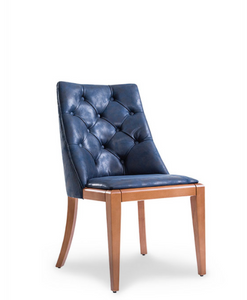 Navy blue, tufted leather dining chair. No arms. Natural wood frame and curved back legs. Front 3/4 view.