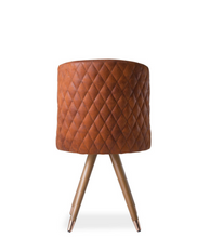 Brown leather barrel chair with quilted back and angled wood legs. Back view.