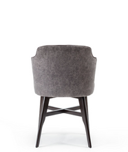 wrap around tub chair with grey fabric seat and black wood legs with decorative crossbar. Back view.