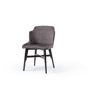 wrap around tub chair with grey fabric seat and black wood legs with decorative crossbar. Front 3/4 view.